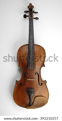 Violin (fiddle) front view isolated on white background with clipping path. String instrument of the violin family. - stock photo