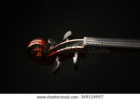 Violin neck on dark background - stock photo