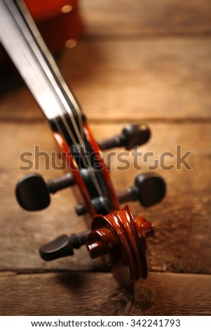 Violin neck on wooden background - stock photo