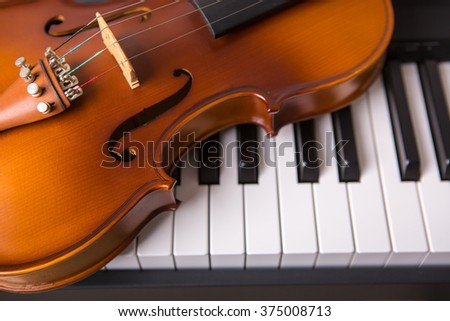 Violin on the piano  - stock photo