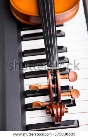Violin on the piano on top view - stock photo