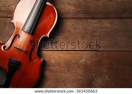 Violin on wooden background - stock photo
