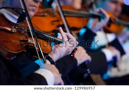 Violin players close up during a classical concert music - stock photo