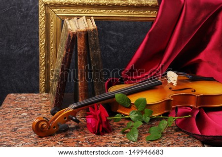 Violin, red rose, burning candle, drapery and old books - stock photo