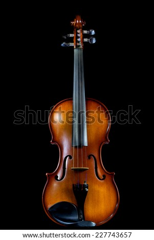 Violin stand on table with nice reflection and isolated on black background - stock photo