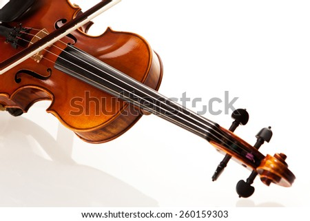 Violin with bow in front of white background - stock photo