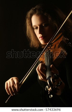 violinist musician violin player Classical music play woman hands on black background - stock photo