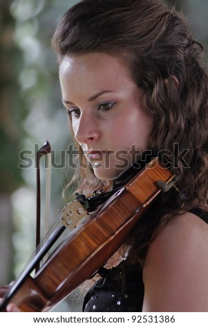 Violinist (2) Young woman playing violin - stock photo