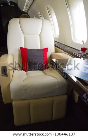 VIP Business Jet Interior with leather chair - stock photo