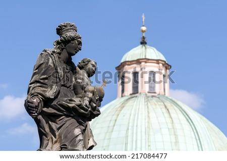 Virgin Mary and child Christ statue on the Charles Bridge, Prague, Czech Republic. - stock photo