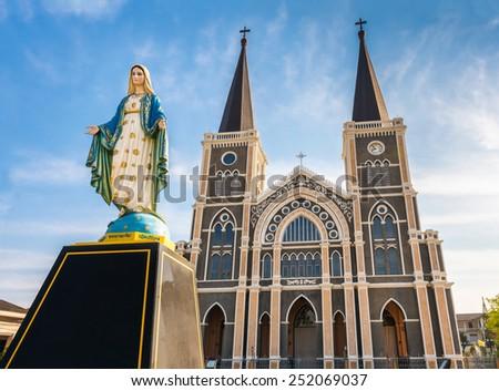 Virgin Mary Statue And Roman Catholic Church - stock photo