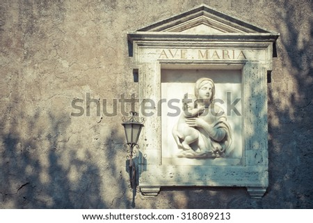 Virgin Mary with baby Jesus on the wall, Rome - stock photo