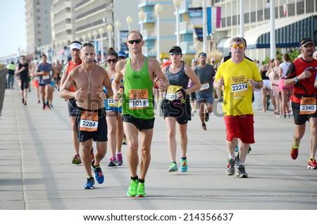 VIRGINIA BEACH, VIRGINIA - AUGUST 31: Runners compete in the Rock N Roll Virginia Beach 1/2 Marathon in Virginia Beach, Virginia August 31, 2014 - stock photo