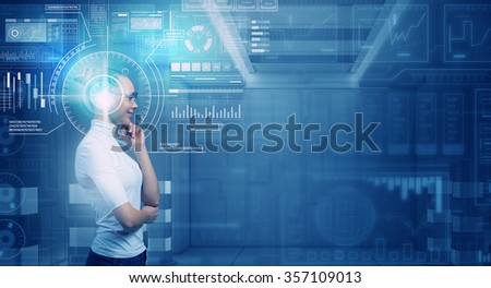 Virtual holographic interface and young thoughtful woman wearing glasses - stock photo