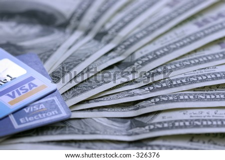 Visa cards and cash - stock photo