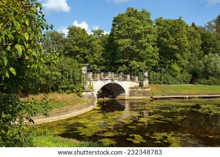 Visconti Bridge built in 1803, project by Vincenzo Brenna in Pavlovsk Park, Saint Petersburg, Russia - stock photo