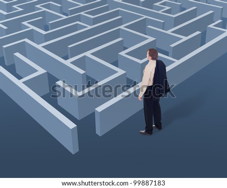 Vision and strategic thinking in business concept - businessman looking to a maze from above - stock photo