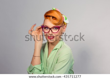 Vision. Closeup attractive  fashion sexy girl wearing eye glasses woman holding pair of glasses taking them off she doesn't need anymore surgical correction of eyesight concept yellow background wall - stock photo