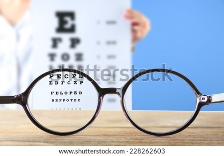Vision concept. Eye glasses on wooden table - stock photo