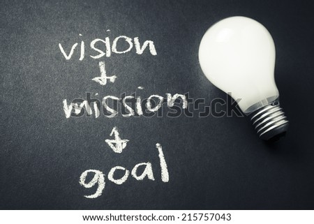 Vision, mission and goal with light bulb - stock photo