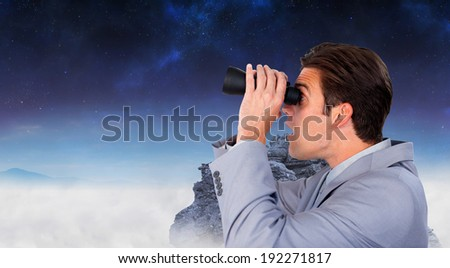 Visionary businessman looking to the future against rocky landscape - stock photo