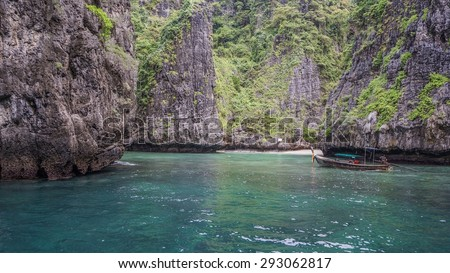 visiting phi phi leh in thailand by long tail boat - stock photo
