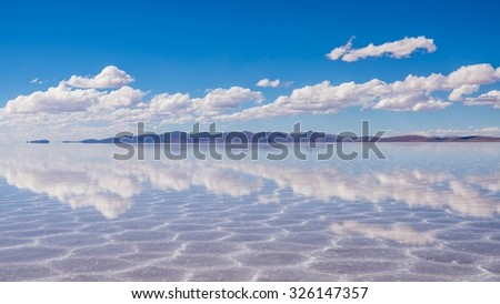 visiting the awesome salt flats of uyuni - stock photo