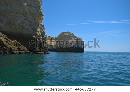 Visiting the cliffs and caves in a tourist boat in Carvoeiro, Algarve, Portugal. Travel and vacation destinations - stock photo