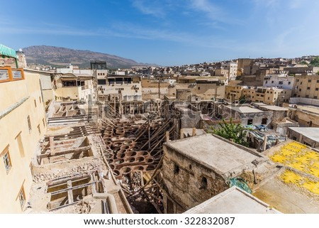 visiting the famous tanneries of fes - stock photo
