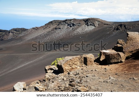 Visitors can hike around the Mount Halaekala crater rim in Maui.  - stock photo