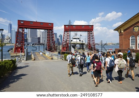 Visitors from Governors Island returning on the ferry to Manhattan, New York City, U.S.A., August 4th 2014, 4:25 p.m. - stock photo