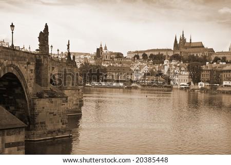 Vista of Prague near the Charles Bridge-sepia tones. - stock photo