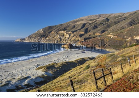 Vista of the California coastline taken from the Pacific Coast Highway (SR 1) in Big Sur near sunset. - stock photo