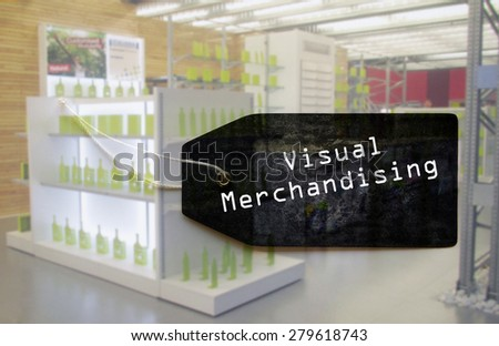 Visual merchandising tag on blurred brand new fashion clothes store background. - stock photo
