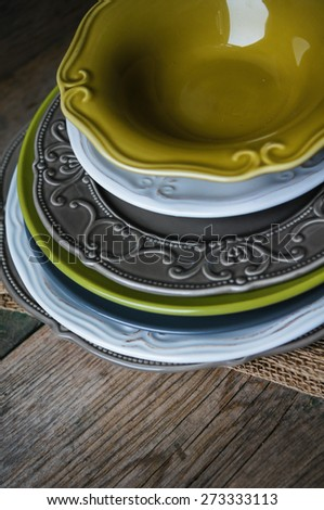 Vitage plates on the wooden table - stock photo