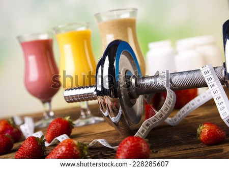 Vitamin and Fitness diet, dumbell  - stock photo