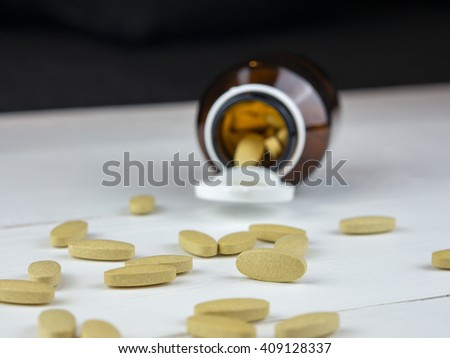 Vitamin C capsules; selective focus, with opened bottle - stock photo