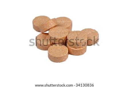 vitamin C pills heap on white - stock photo