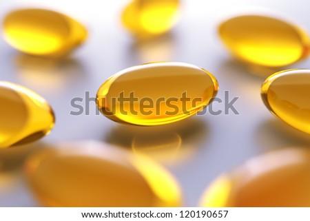 vitamin capsules background - stock photo