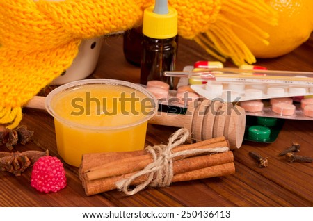Vitamin concept - close up of honey and pills - stock photo