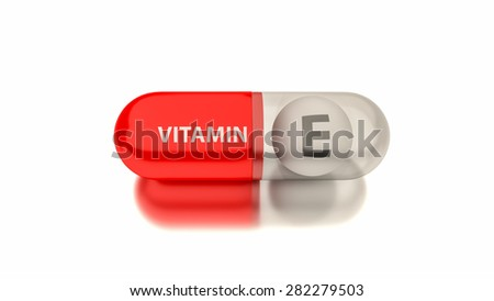 Vitamin E in red capsule. Conceptual image for health concepts. - stock photo