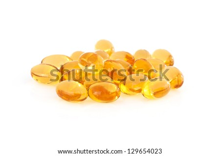 Vitamin E supplement capsules closeup on a white background - stock photo