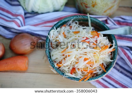 Vitamin salad of shredded cabbage and carrots, food top view - stock photo