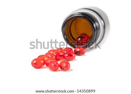 Vitamin tablets on a white background (selective focus) - stock photo