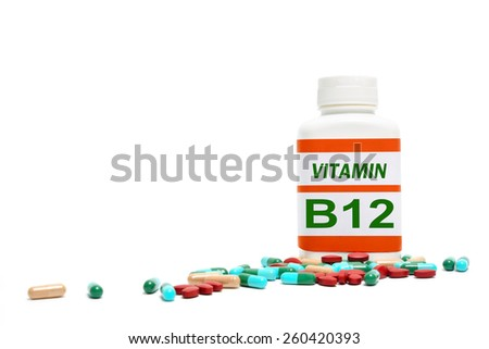 vitamins, pills and tablets on white background - stock photo