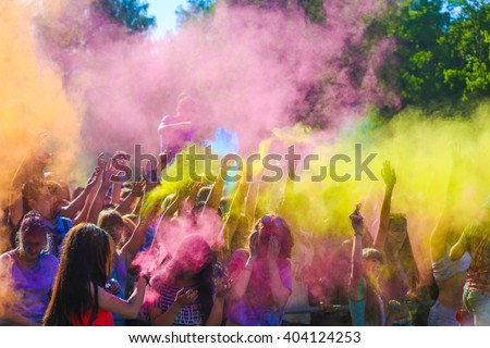 Vitebsk, Belarus - July 4, 2015: Throwing color at the Holi color festival - stock photo
