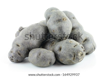 Vitolette noir or purple potato. On a white background. - stock photo