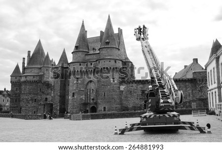 VITRE, FRANCE - JULY 12, 2014: Firemen carry out training exercise near the castle of Vitre. The castle of Vitre was built in 11th century and rebuilt at 13th century. - stock photo
