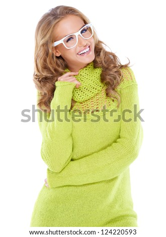 Vivacious beautiful woman with curly long blonde hair wearing modern white framed glasses and a warm winter jumper isolated on white - stock photo