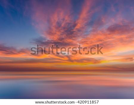 Vivid beautiful sunset and sunrise sky reflection on lake. - stock photo